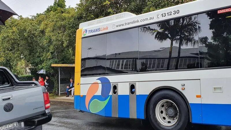 The bus does not pick up any passengers but stops for several seconds at the intersection before turning right into Hamilton Rd, Moorooka.